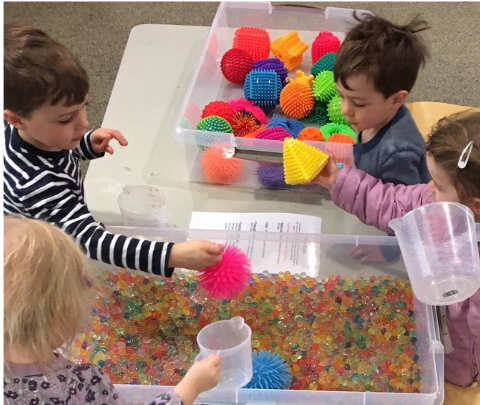 image of toddlers playing with sensory toys
