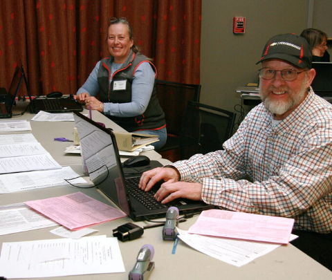 image of tax volunteers with computers