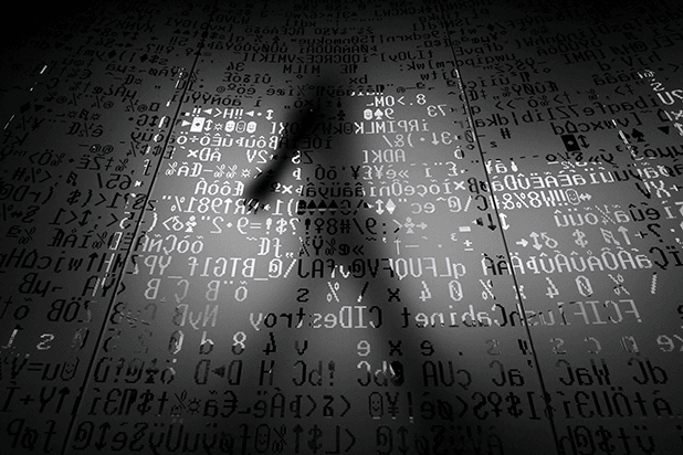 image of shadowy figure and computer screen
