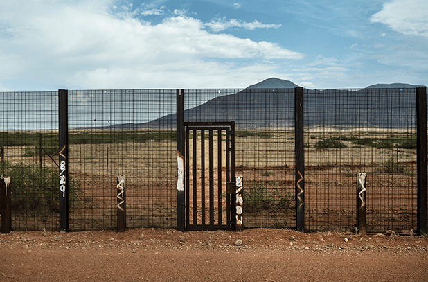image of border fence between us and mexico