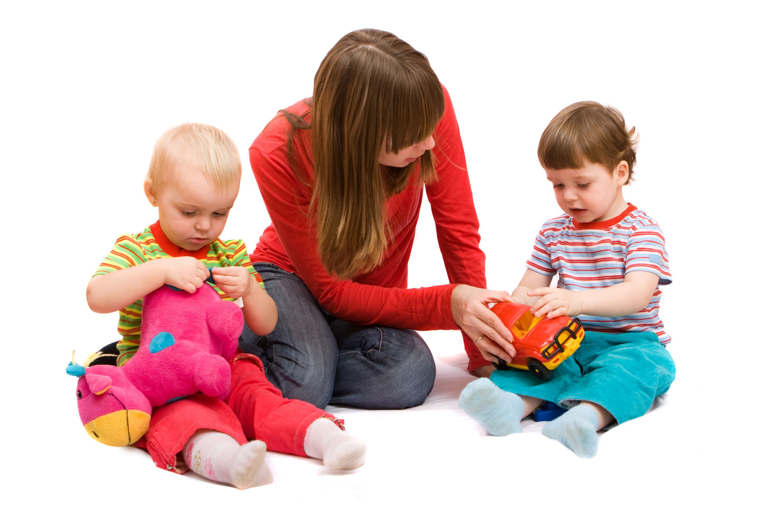 image of a woman playing with two small children