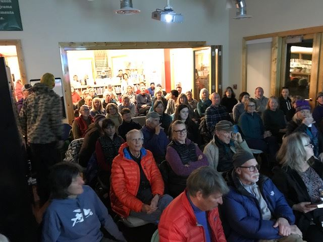 image of Alta community room packed with people listening to a speaker